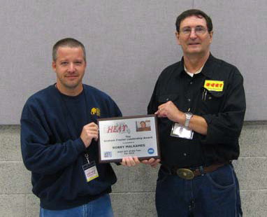 Robby (on left) receiving award from Bill Hills, previous HEAT President